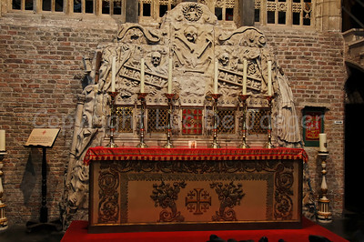 The altar on the inside the Jeruzalemkerk (Church of Jerusalem) in Bruges (Brugge), Belgium. A must-see if you visit Bruges. It's a private church, built in the 15th Century as a private Chapel and still property of the family Adornes who originally built this chapel. It is believed that the design was copied from the Church of the Holy Sepulcher in Jerusalem, which some of the members of the family had visited. Remarkable is that the church/chapel is still intact in its original form.