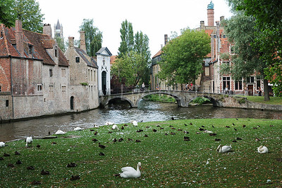 View on the bridge leading to the beguinage in Bruges (Brugge), Belgium.