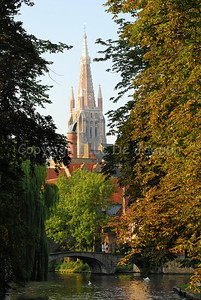 The Onze-Lieve-Vrouwekerk (Church of Our Lady) and the bridge leading to the Beguinage (Begijnhof) on the Wijngaardplein in Bruges (Brugge), Belgium; shot late in the afternoon.