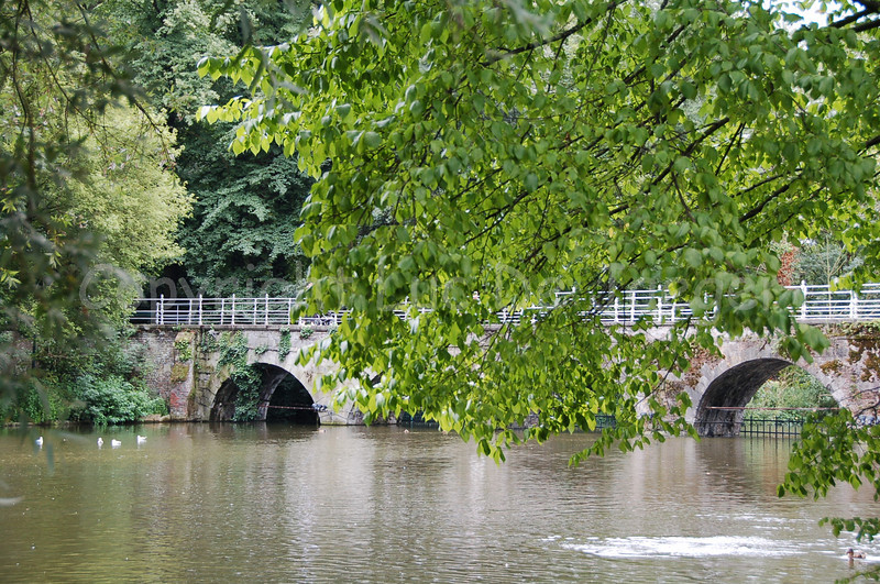 Bridge (built in 1740) in the Minnewaterpark in Bruges (Brugge), Belgium. Shot with the Nikkor 18-200mm zoom lens. No post processing at all.