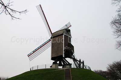 One of the four mills (molens) situated along the Kruisvest in Bruges (Brugge), Belgium. This one is the Sint-Janshuismolen, the 2nd counting from the Kruispoort. Unfortunately, it was a cloudy day.