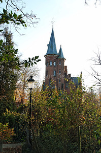 The Minnewater Castle (Minnewaterkasteel) in the Minnewaterpark in Bruges (Brugge), Belgium.
