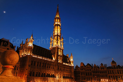 The Town Hall (Stadhuis) on the Market square (Grote Markt) in Brussels (Brussel), Belgium captured at night. The Town Hall was constructed in the 15th Century. The white dot on the left of the photo is the Moon.