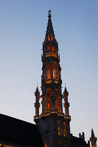 The gothic tower of the Town Hall (Stadhuis) on the Market square (Grote Markt) in Brussels (Brussel), Belgium captured at dusk.
