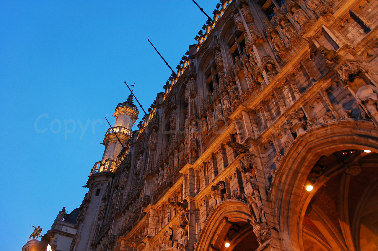 The Town Hall (Stadhuis) on the Market square (Grote Markt) in Brussels (Brussel), Belgium captured at dusk. The Town Hall was constructed in the 15th Century.