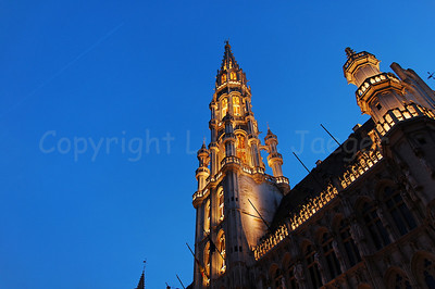 The gothic tower of the Town Hall (Stadhuis) on the Market square (Grote Markt) in Brussels (Brussel), Belgium captured at night.