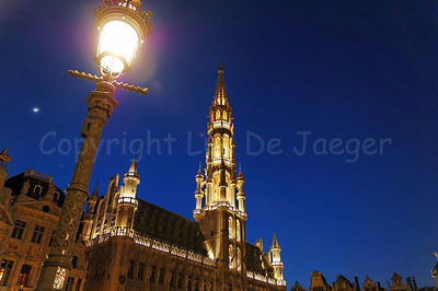 The Town Hall (Stadhuis) on the Market square (Grote Markt) in Brussels (Brussel), Belgium captured at night. The Town Hall was constructed in the 15th Century. The white dot aside from the street lighting to the left is the Moon.