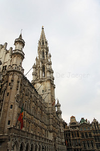 The gothic tower of the Town Hall (Stadhuis) on the Market square (Grote Markt) in Brussels (Brussel), captured in the late afternoon, Belgium. The Town Hall was constructed in the 15th Century.