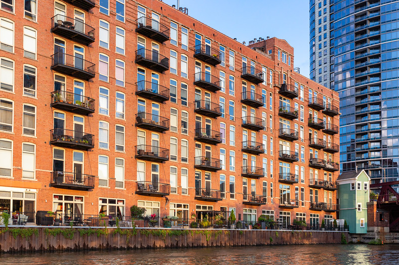 Old warehouse converted into apartments on the river.