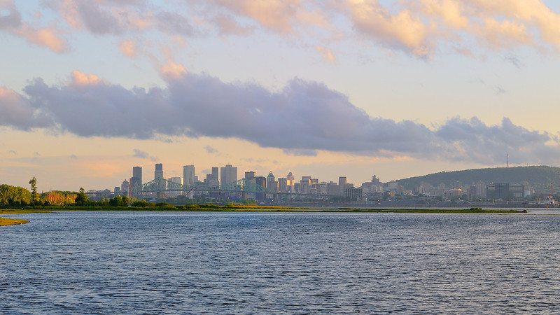 Sunset time for Montreal city and the mountain as seen from St-Lawrence river
