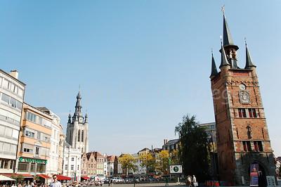 The main Market Square in Courtrai (Kortrijk), Belgium. To the right is the Belfry (Belfort) and left is the Saint Martin Church (Sint Maartenskerk).
