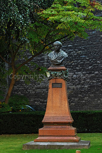 A statue of Guido Gezelle beside the Church of Our Lady (Onze Lieve Vrouwekerk) in Courtrai (Kortrijk), Belgium.