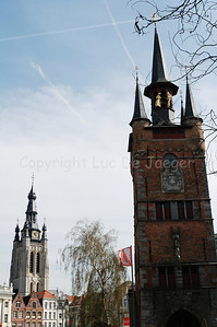 The Belfry (Belfort) on the right and the tower of the Saint Martin Church (Sint Maartenskerk) on the left, in Courtrai (Kortrijk), Belgium. The Belfry is classified by the UNESCO as a World Heritage Site.