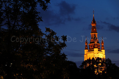 The tower of the Saint Martin Church (Sint Maartenskerk) in Courtrai (Kortrijk), Belgium, captured from the Begijnhofpark at dusk.