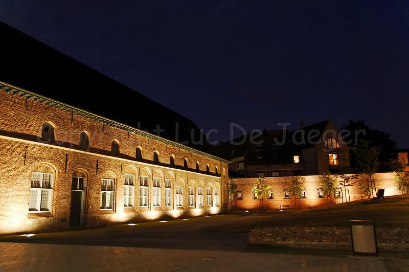 The Begijnhofpark with the Groeninge Abbey (Groeningeabdij) in Courtrai (Kortrijk), Belgium, captured at dusk.