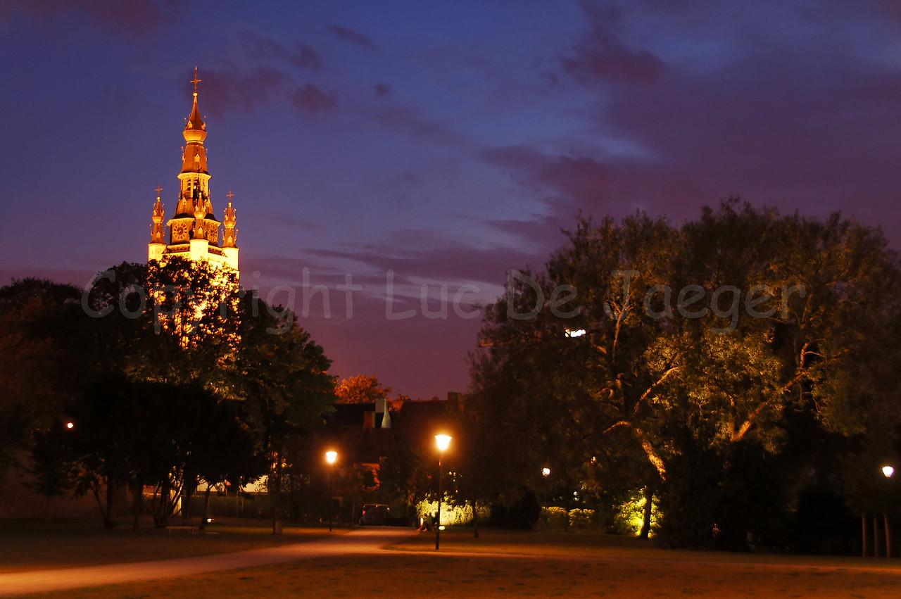 The tower of the Saint Martin Church (Sint Maartenskerk) in Courtrai (Kortrijk), Belgium, captured from the Begijnhofpark at dusk.