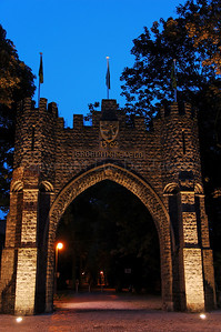 The Groeninghe Gate (Groeninghe Poort) in Courtrai (Kortrijk), Belgium, captured at dusk. The Gate marks the entrance of the Groeningekouter (a small park in which is found the Groeninghe Monument/Statue to commemorate the 600th anniversary of the famous Battle of the Golden Spurs).