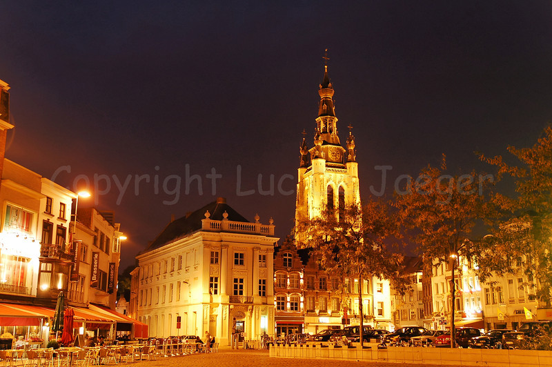 The Market Square in Courtrai (Kortrijk), Belgium, with a view on the Saint Martin Church (Sint Maartenskerk). Image captured at night.