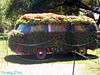 VW bus covered in flowers.