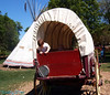 I just thought the kids were cute playing in the covered wagon.