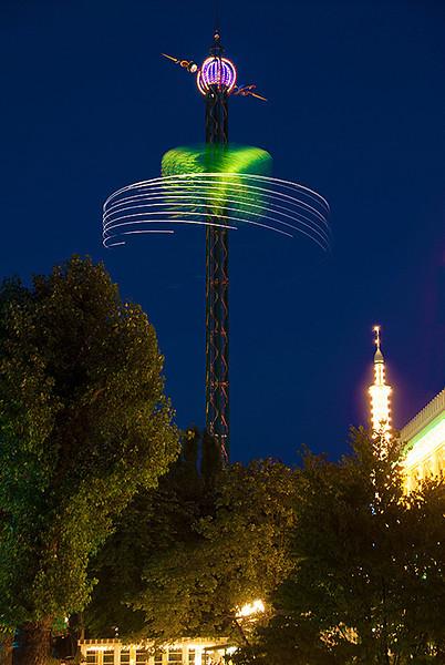 The Star Flyer, 262 foot (80m) high swing carousel in the Danish amusement park, Tivoli Gardens, Copenhagen, Denmark at night