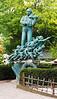 Cherub statue at Tivoli Gardens amusement park, Copenhagen, Denmark.