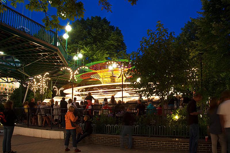 The Spinning Top in the Danish amusement park, Tivoli Gardens, Copenhagen, Denmark at night
