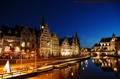 Evening shot of the Graslei (to the left) and St Michielsbrug (St Michael's Bridge near the Corn Market, Korenmarkt) in the city of Ghent, Belgium. It's a pity there is not that much Christmas lighting or atmosphere! Shot around Xmas 2006.