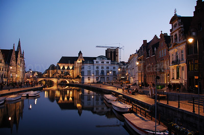 Evening shot of the St Michielsbrug (St Michael's Bridge near the Corn Market, Korenmarkt), Graslei and Korenlei in the city of Ghent (Gent), Belgium.