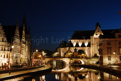 Evening shot of the St Michielsbrug (St Michael's Bridge near the Corn Market, Korenmarkt) and Graslei in the city of Ghent, Belgium. It's a pity there is not that much Christmas lighting or atmosphere! Shot around Xmas 2006.