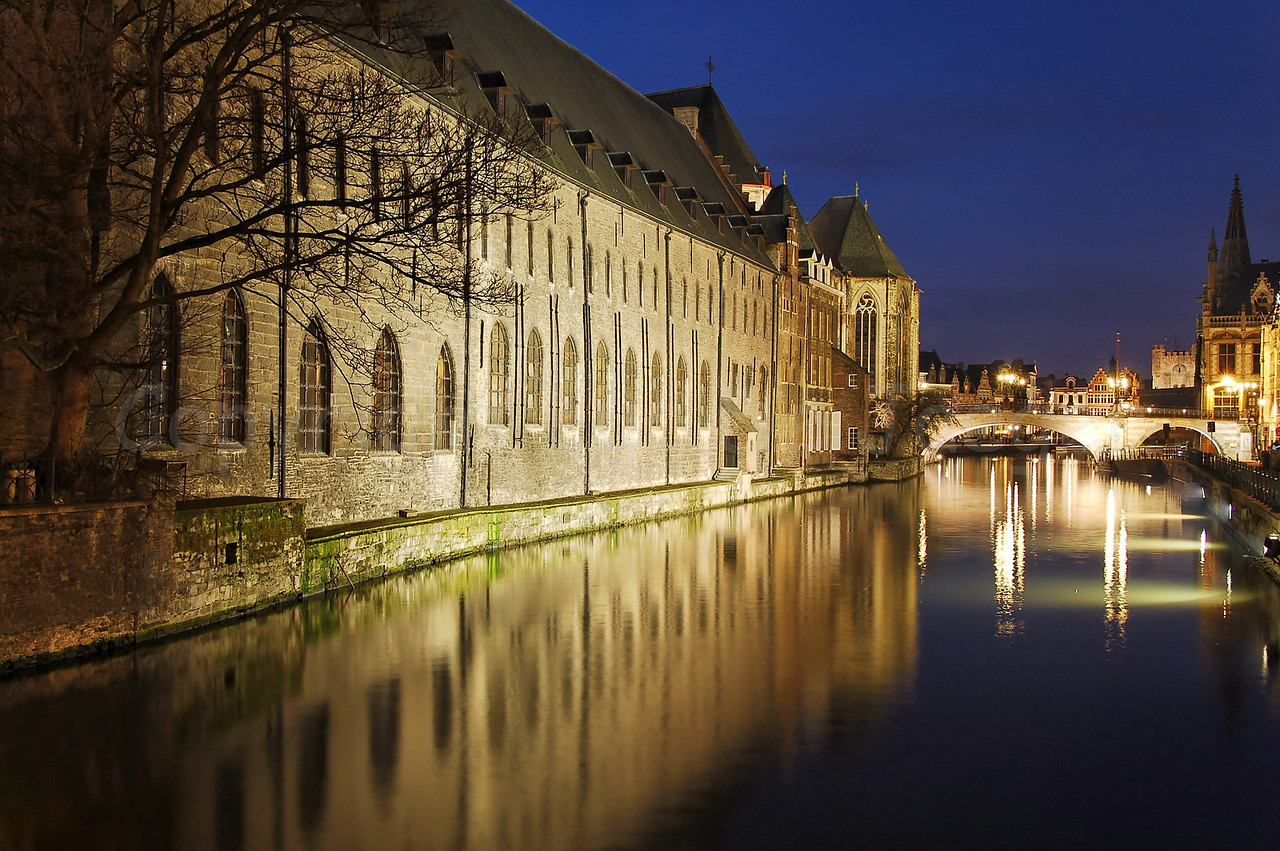 """Evening shot of the St Michielsbrug (St Michael's Bridge) in the city of Ghent (Gent), Belgium. Image shot from the Predikherenbrug. The building left is """"het Pand."""""""