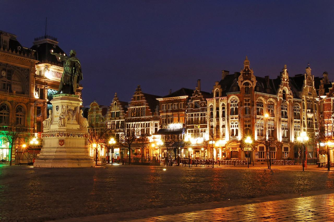 Night image of the Vrijdagmarkt in Ghent (Gent), Belgium. To the left is the statue of Jacob Van Artevelde.
