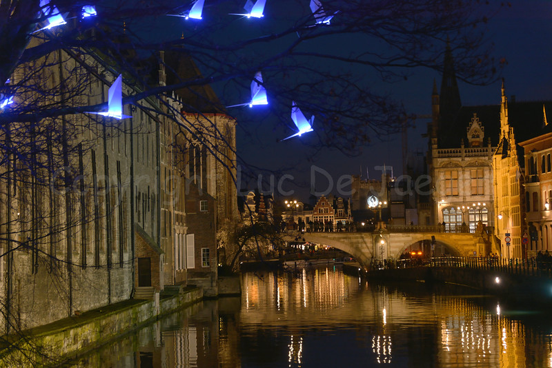 The Blue Birds, a light-installation by the French creative studio Pitaya. This project was one of the highlights of the 2012 Ghent Light Festival and is since November 2016 permanently part of the award-winning lighting plan of Ghent (Gent) and to be seen at the Predikherenlei. The work took inspiration from the famous fairy tale L'Oiseau Bleu (The Blue Bird) by the Ghent Nobel Prize winner Maurice Maeterlinck.