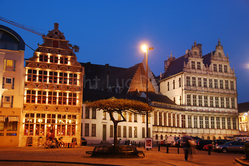 Evening shot of the Emile Braunplein in the center of the city of Ghent (Gent), Belgium. The white building to the right is the Town Hall.
