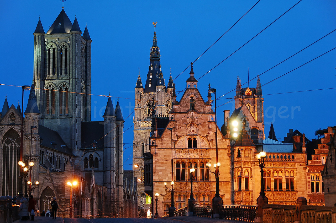 The three Towers in Ghent (Gent), Belgium: left: the Sint Niklaaskerk (Church of St Nicolas) center: the Belfort (Belfry) right (behind the buildings): Sint Baafskathedraal (Cathedral of St Bavo)