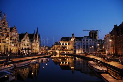 Evening shot of the St Michielsbrug (St Michael's Bridge near the Corn Market, Korenmarkt), Graslei and Korenlei in the city of Ghent (Gent), Belgium.