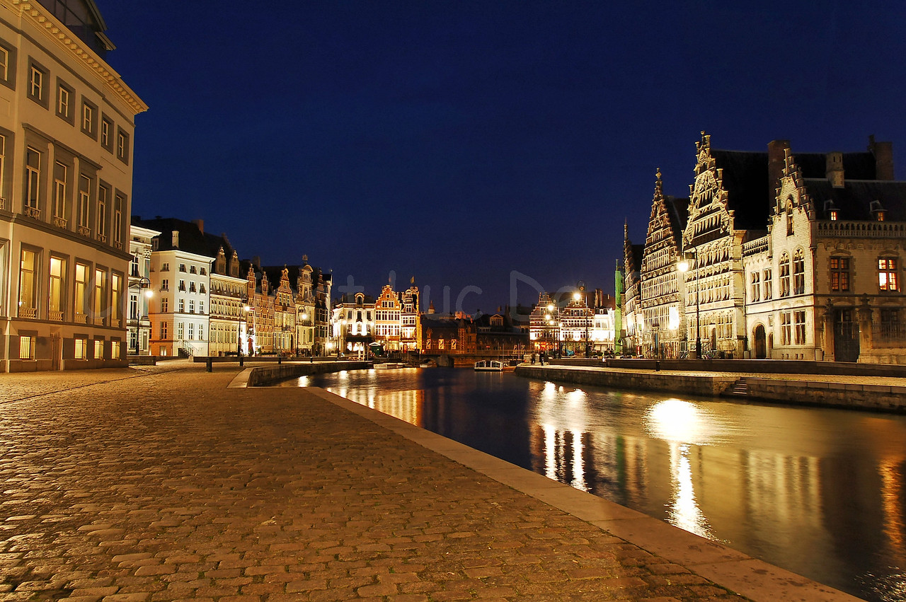 Evening shot of the Korenlei (left) and Graslei (right) in the city of Ghent (Gent), Belgium. Captured with the back to the St Michael's Bridge (Sint Michielsbrug).