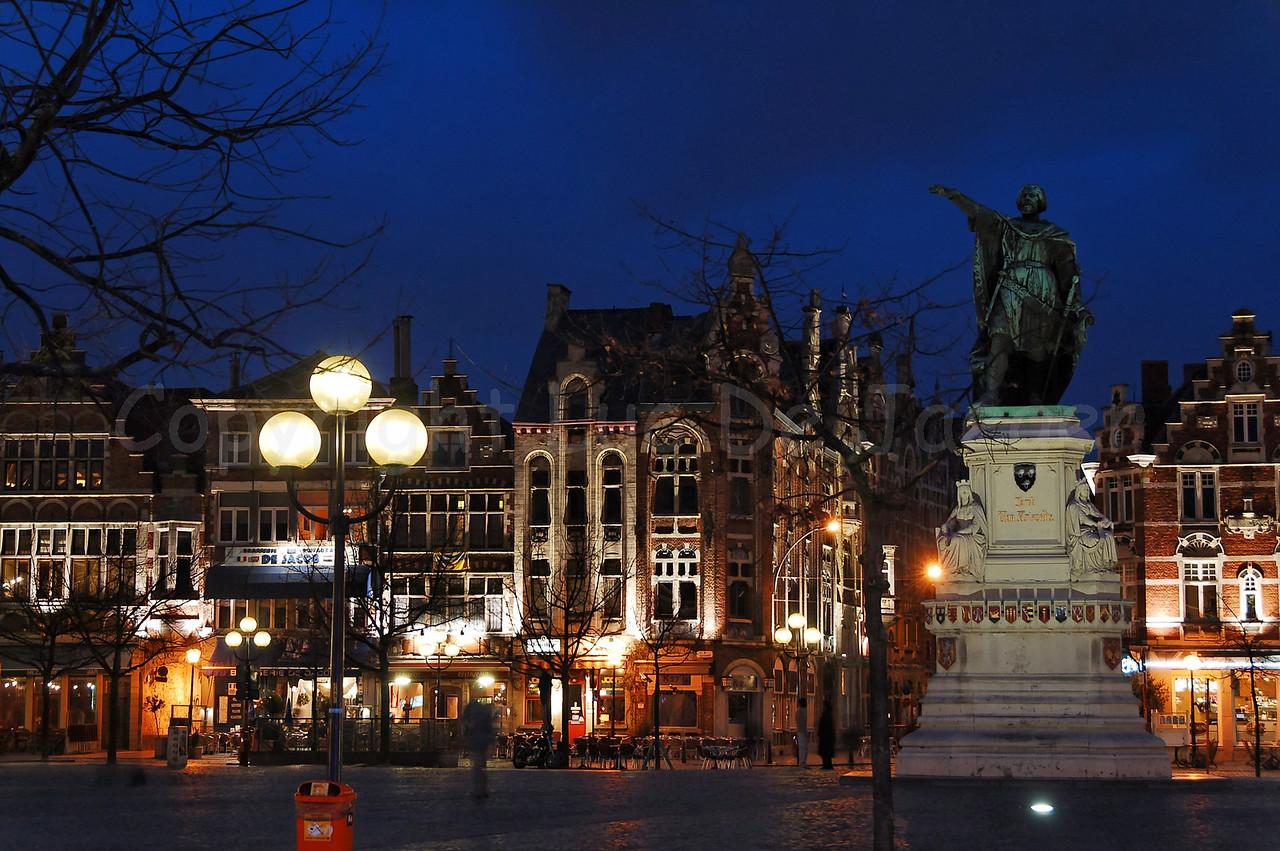 Night image of the Vrijdagmarkt in Ghent (Gent), Belgium. To the right is the statue of Jacob Van Artevelde.