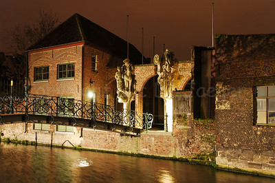 The Emperor Charles V bridge along the Sint Antoniuskaai and the river Lieve in the surroundings of the Prinsenhof quarter in Ghent (Gent), Belgium captured at dusk. The statues are from the hand of Walter de Buck.