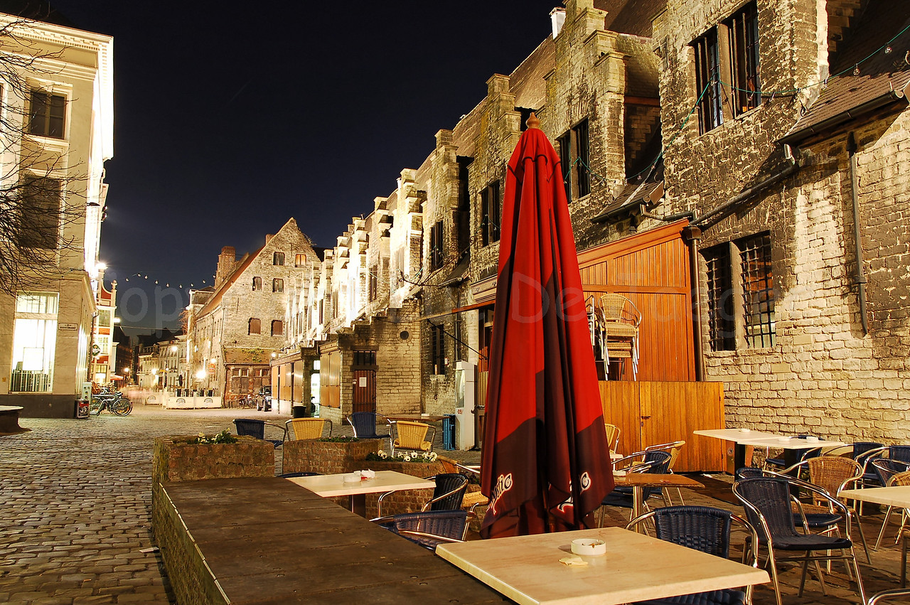 Night image of the Pensmarkt aside of the Groentenmarkt in the city of Ghent (Gent), Belgium.