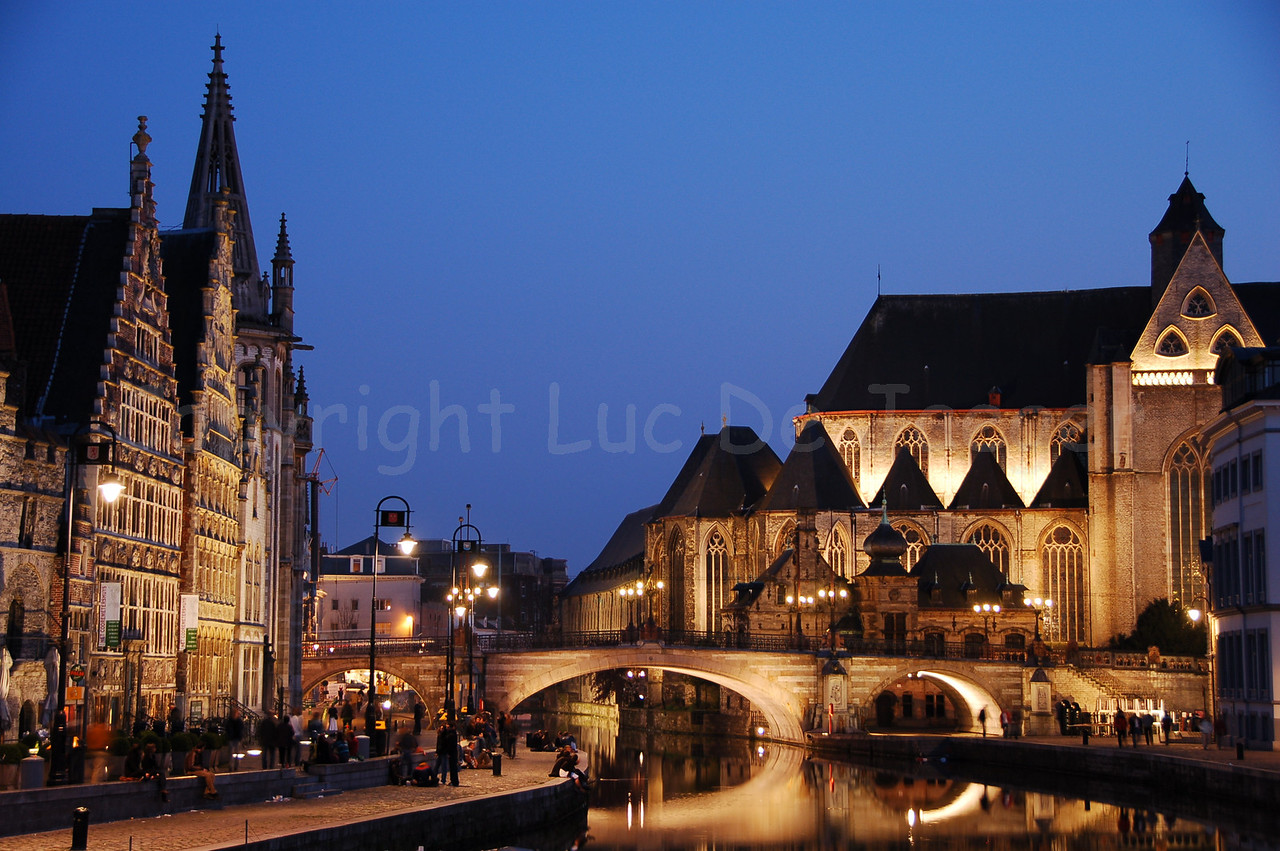 Evening shot of the St Michielsbrug (St Michael's Bridge near the Corn Market, Korenmarkt) and Graslei in the city of Ghent (Gent), Belgium.