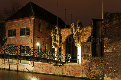 The Emperor Charles V bridge along the Sint Antoniuskaai and the river Lieve in the surroundings of the Prinsenhof quarter in Ghent (Gent), Belgium captured at dusk. The statues in front are from the hand of Walter de Buck.