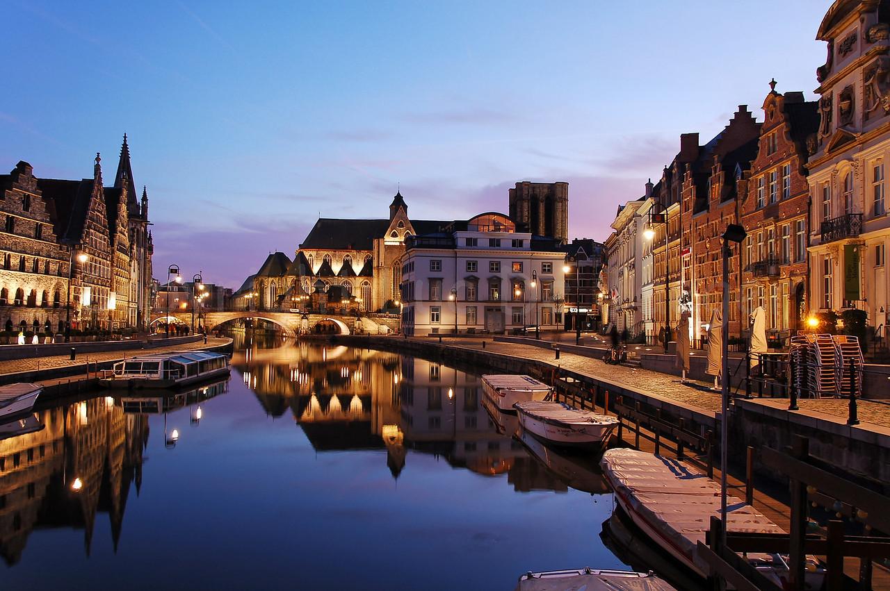 Evening shot of the St Michielsbrug (St Michael's Bridge) near the Corn Market, Korenmarkt), Graslei and Korenlei in the city of Ghent (Gent), Belgium.