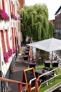 """View on the """"de Acht Zaligheden"""", a restaurant situated along Oudburg in Ghent (Gent); Belgium. This photo is captured from the Zuivelbrug (the back walls of Oudburg)."""