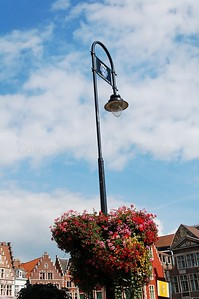 Streetlights and flower baskets on the Graslei and Korenlei in Ghent (Gent), Belgium.