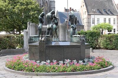 """Statue (""""Bron der Geknielden"""" by George Minne) on the Emile Braunplein in Ghent (Gent), Belgium."""