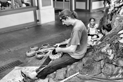 A local family practicing their craft on the streets of Hilo, Hawaii