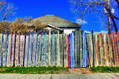 Clever use of skis as a fence surrounding a house just off the main drag in Jackson, Wyoming.