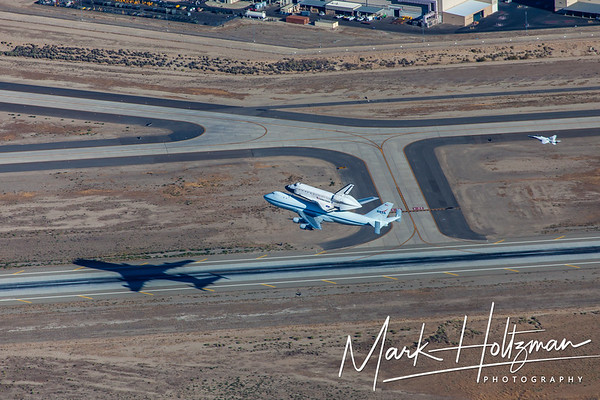 Space Shuttle Endeavour over the runway of Palmdale Airport in front of Lockheed Martin Skunk Works in Palmdale, CA.
