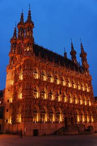 The Town Hall in Louvain (Leuven), Belgium captured at dusk.